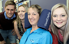 TravelComfort Pty Ltd owner Prue Kelly tries out her travel pillow, surrounded by USC students Joshua Crisp, Eleanor Berry and Shannon Sutton
