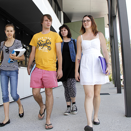 Four USC Gympie students walking together