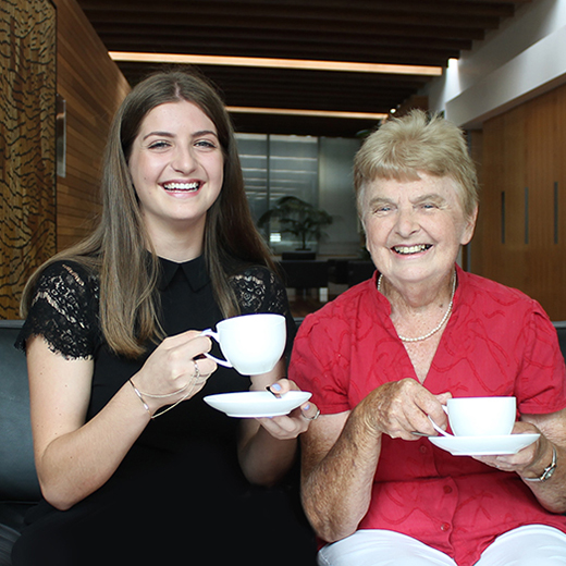 Erin McLaren and her grandmother Lorraine drinking a cup of tea