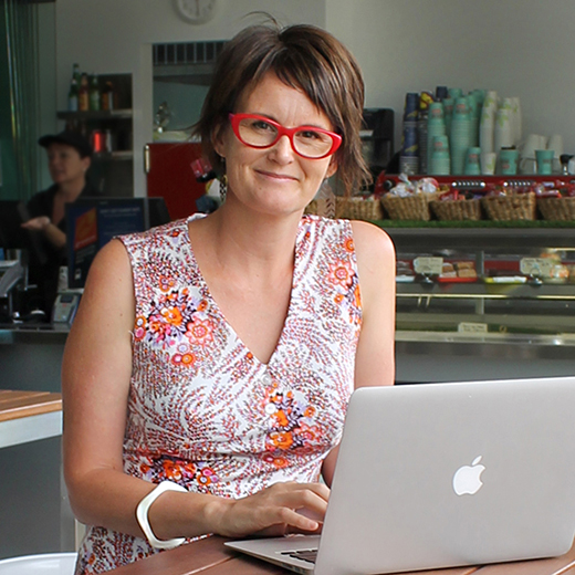 Toni Wills with her laptop at a Cafe