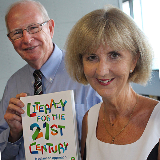 Carol Smith holds Literacy for the 21st Century book with Rod Campbell in background