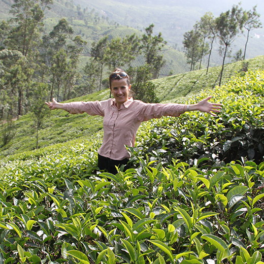 Tara McKenzie standing in a tea plantation