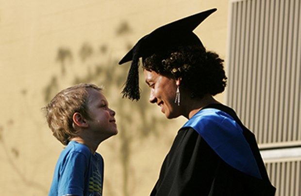 Graduand with her son