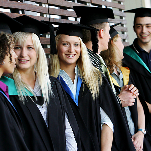 A group of students in graduation gowns
