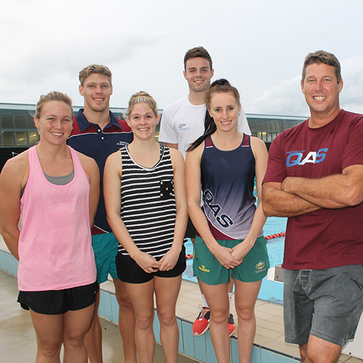 Chris Mooney, right, with five of his charges (from left) Kylie Palmer, Jake Packard, Leah Neale, Julian Layton of New Zealand and Taylor McKeown.