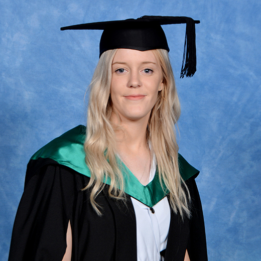 Kate Morris wearing a graduation gown and mortar board