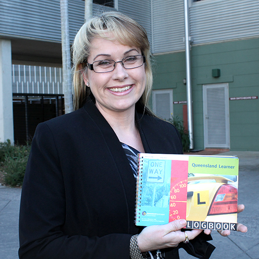 Dr Bridie Scott-Parker holds a Learner logbook