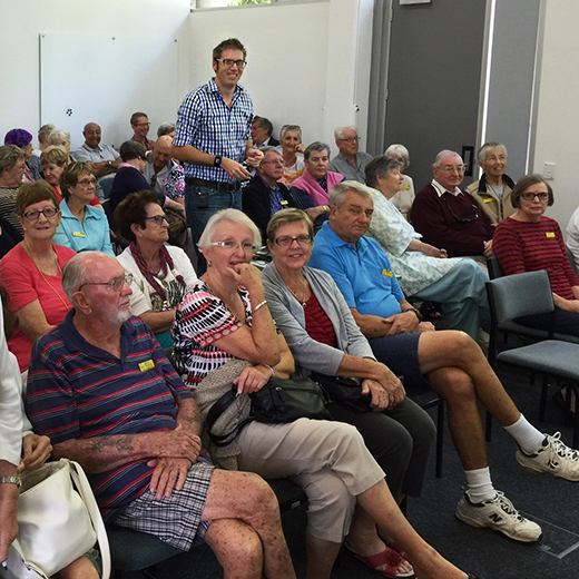 a group of U3A participants listening to a lecture