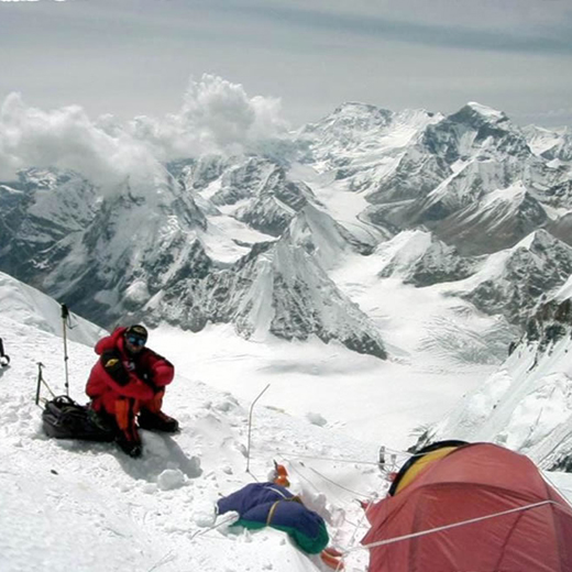 Adrian McCallum surrounded by snow in the Himalayas