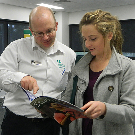 A USC Business academic provides advice to a prospective student at a previous USC Gympie Open Day