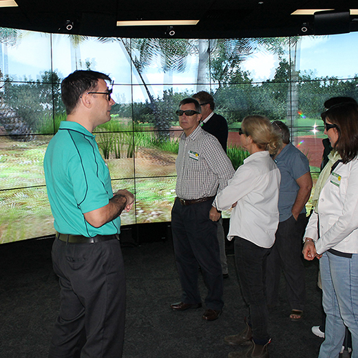 USC technician Simon Orsborn explains the 3D visualisation theatre to USC staff and stakeholders