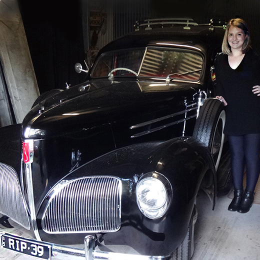 USC SouthBank graduand Lucy Delaforce inspects a hearse at the Boggo Road Gaol