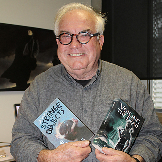 Associate Professor Gary Crew with two of his novels