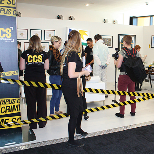 Visitors to the TSXPO in Brisbane inspect USC's crime scene.