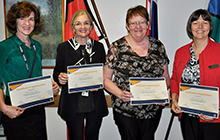 USC academics Professor Jeanine Young, Dr Amanda Henderson, Associate Professor Margaret Barnes and Professor Marianne Wallis display certificates from the Sunshine Coast Hospital and Health Service