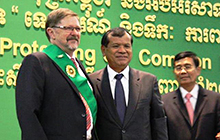 USC Associate Professor Bill Carter accepts the award from Cambodia's Minister of Tourism Dr Thong Khon and the Director General of Tourism Chantha Tith
