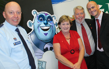 USC Associate Professor Christian Jones with Bruce and Denise Morcombe, Queensland Police Service Sunshine Coast District Superintendent Maurice Carless and one of Orbit's main characters, Tau the Technology Guy