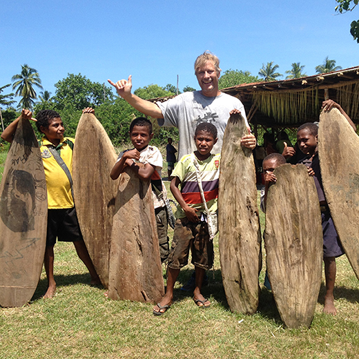 University of the Sunshine Coast PhD student Tom Wegener with children in PNG.