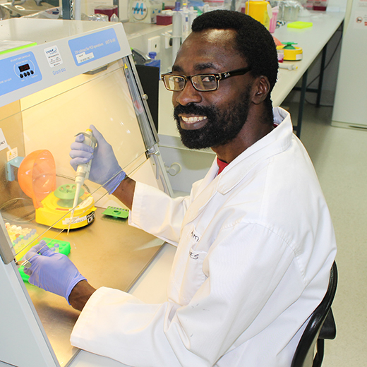 USC PhD researcher Ameh James conducting testing in the laboratory.