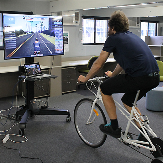 PhD student Rafael Upcroft testing out the virtual reality bicycle simulator.