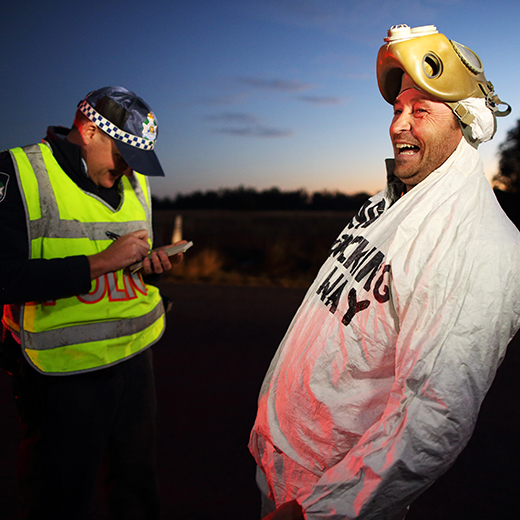 An image from Frackman showing activist Dayne Pratzky talking to police.