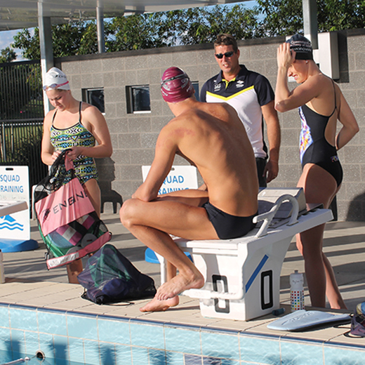 Chris Mooney leading a training session of the USC High-Performance Swimming Program squad.