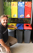 USC Operations and Project Officer Paul Camilleri with one of the recycling stations being introduced around campus