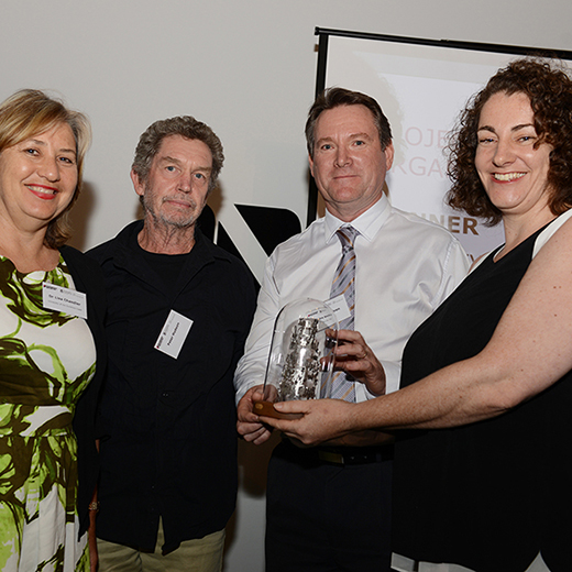 USC's Dr Lisa Chandler, artist Peter Hudson and Blue Sky View's John Waldron accept the 2015 Gallery and Museum Achievement Award for East Coast Encounter from Museums & Galleries Queensland's Executive Director Rebekah Butler.