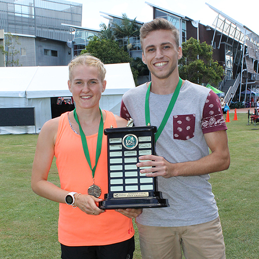 Ebony Wilson and Nathan Hayes with the perpetual Spartan Court Race trophy.