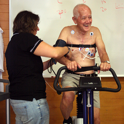 A VasoActive researcher checking the equipment on a study participant.