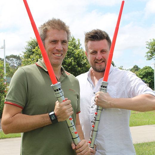 USC Professor of Human Factors Paul Salmon and Dr Guy Walker brandishing lightsabers as they consider risk assessment research.