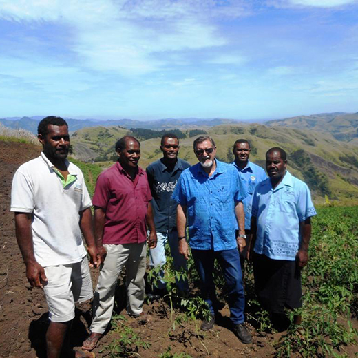 Dr Rob Erskine-Smith working with Fijians on the vegetable farming project in the Nanoco Highlands.