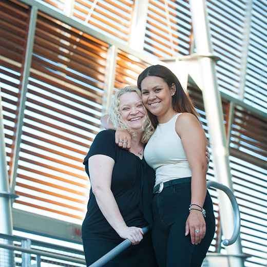 Ann Yardley and her daughter Shari Smith on the steps of the USC Library.
