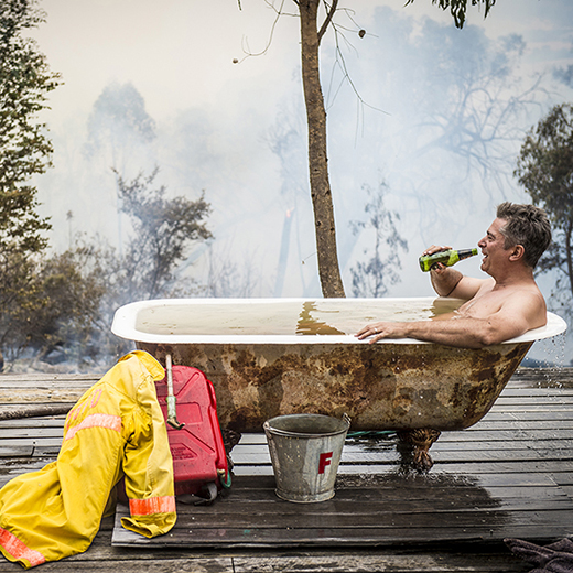 "An image taken by Jason Edwards of the Herald Sun, entitled ""Simon takes a well-earned bath after saving his property""."