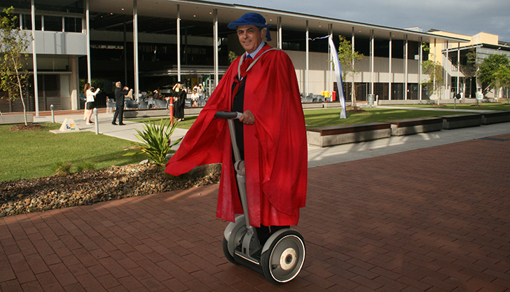 Evan Douglas rides a Segway at Graduation