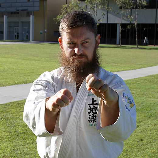 PhD candidate Colin Gavagan, a third dan black belt in Uechi-Ryu Karate.