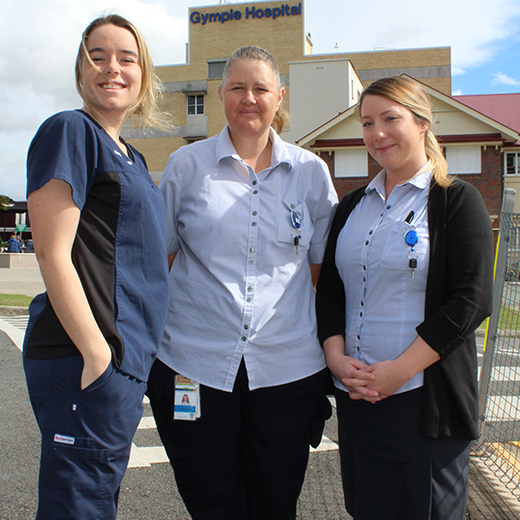 USC graduates  Jaidyn Lorensen, Kitrina Smedes and Katherine Sellick outside Gympie Hospital.