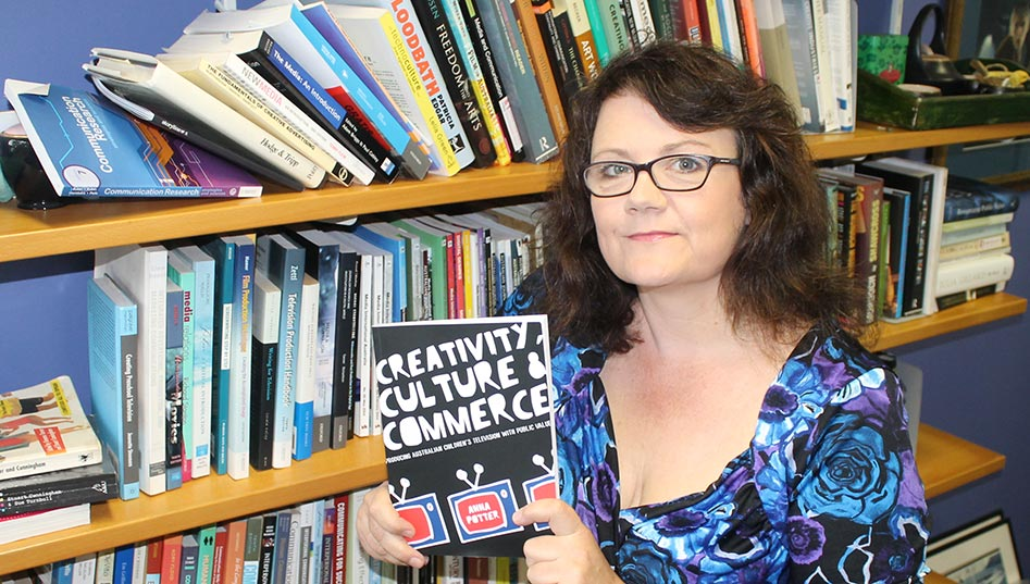 Senior Lecturer in Communication Dr Anna Potter with her book Creativity, Culture & Commerce: Producing Australian Children's Television with Public Value