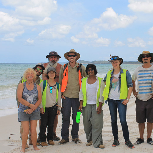 USC lecturer Dr Gabriel Conroy (far right) and Butchulla elder Ian Wheeler (4th from left) with volunteers on a research trip to Fraser Island.