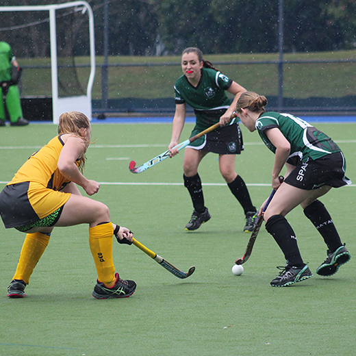 The USC Spartans women's hockey team in action against USQ at Ballinger Park on Tuesday.