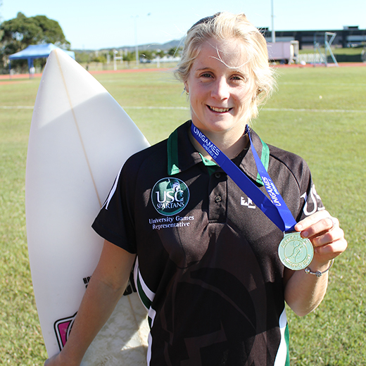 USC surfer Sophie McCulloch displaying her gold medal.