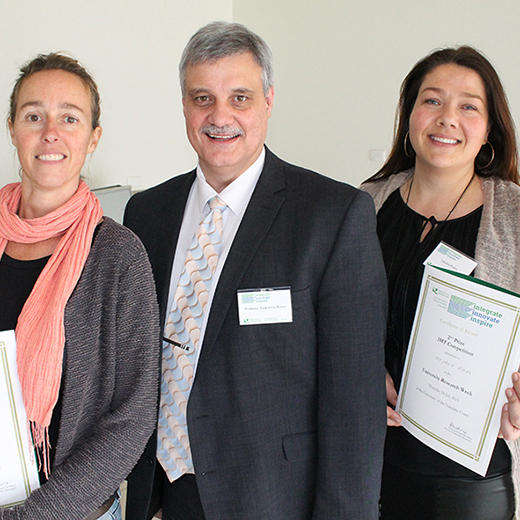 USC's Deputy Vice-Chancellor (Research and Innovation) Professor Roland De Marco presenting awards to the 2015 Three Minute Thesis winners Megan Marks and Tetyana Rocks.