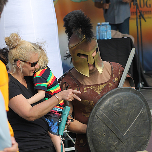 People meeting the USC Spartans mascot at a previous Imaginarium.