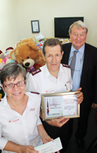 USC Vice-Chancellor Professor Greg Hill (right) with Sue and Dennis McGuigan of the Salvation Army