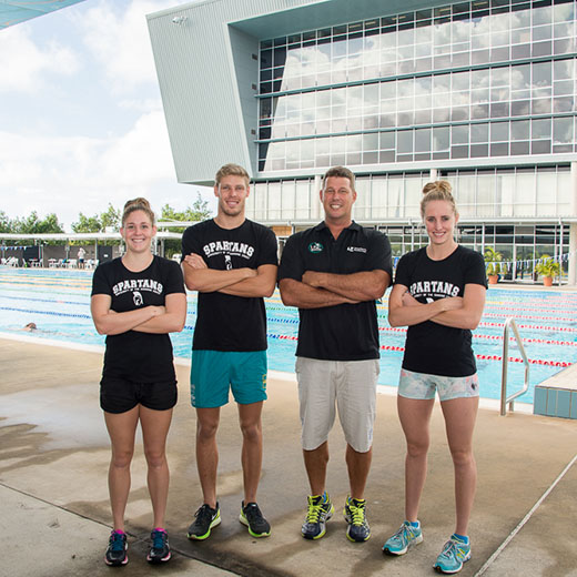 USC Spartans swimmers, from left, Leah Neale, Jake Packard, coach Chris Mooney and Taylor McKeown. Photo credit: Carly Head.