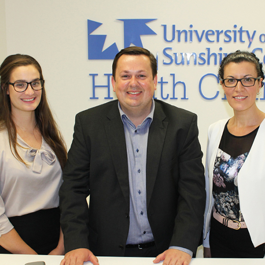 USC Clinical Trials Centre Director Lucas Litewka, centre, with staff members Claire Le Bris, left, and Georgie Street.