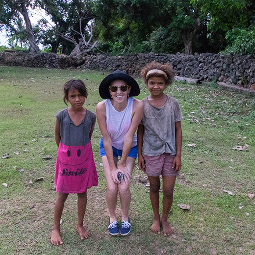 USC graduate Ashleigh Morris meets young villagers in a remote area of Indonesia.