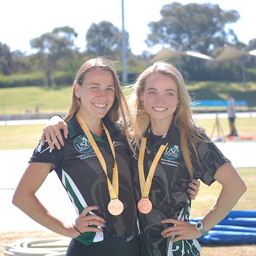 Jessica Haig and Jane Larkin with their bronze medals for athletics.