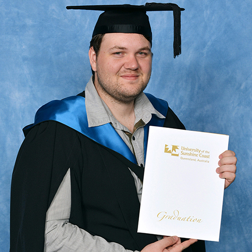 USC Psychology graduate Kyle Elsley at the USC graduation ceremony at Matthew Flinders Anglican College Performance Centre, Buderim. Please credit Silver Rose Photography.