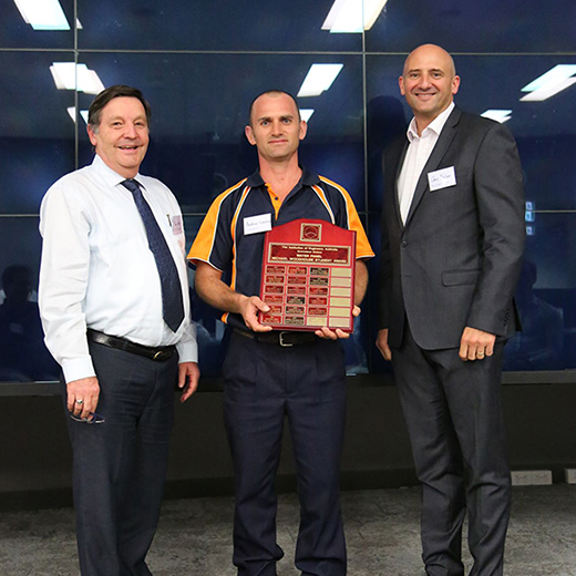 USC student Andrew Lindsay (centre) receiving the Michael Woodhouse Award , accompanied by USC Professor of Engineering Mark Porter (left) and Engineers Australia's Queensland Co-Deputy President Chris Nielsen.